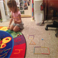A girl playing toys